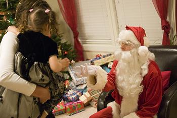 Nicole giving cookie to Santa